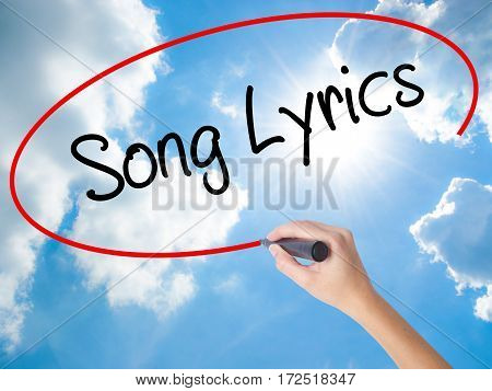 Woman Hand Writing Song Lyrics With Black Marker On Visual Screen