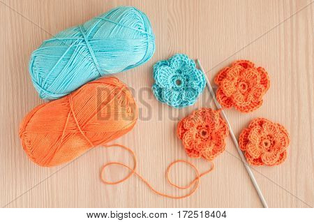 Handmade knitted crochet flowers. Needlework concpt. Top view