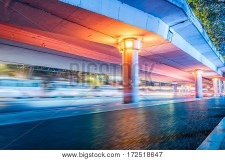 urban traffic with cityscape at night in Shenzhen,China.
