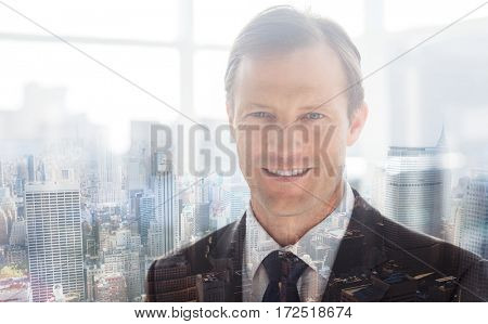 Confident businessman standing in an office