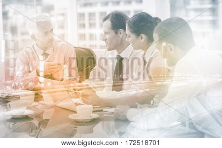 Group of business people brainstorming together in the meeting room