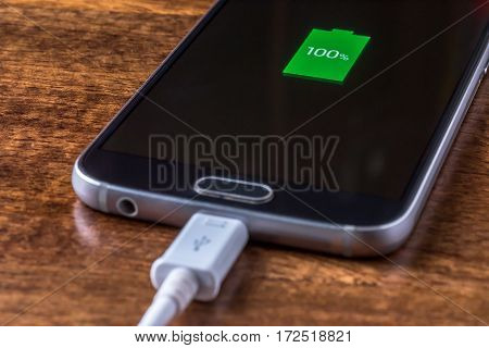 Close up view of smartphone charging battery