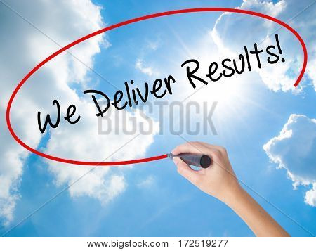 Woman Hand Writing We Deliver Results! With Black Marker On Visual Screen