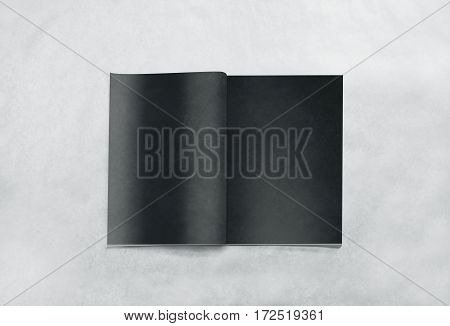 Opened blank magazine black pages mockup, isolated on textured background. Dark journal mock up lying on desk. Catalog spread template. Empty notebook booklet design inside. Book center presentation.