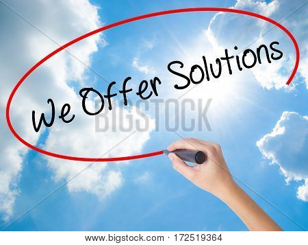 Woman Hand Writing We Offer Solutions With Black Marker On Visual Screen