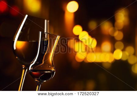 Glasses With White Wine And Liquor On A Background Of Night City
