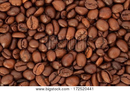 Texture arabica coffee beans closeup. Coffee background