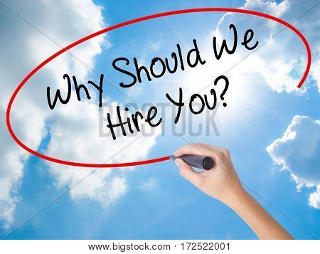 Woman Hand Writing Why Should We Hire You? With Black Marker On Visual Screen