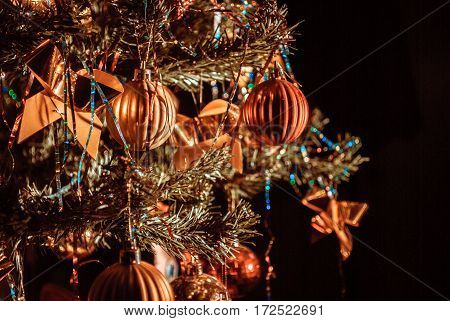 Christmas tree with ornaments. Behind the black background.