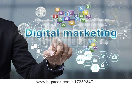Businessman hand chooses Digital marketing wording on interface screen. internet technology service concept. can used for cover page presentation and web banner.
