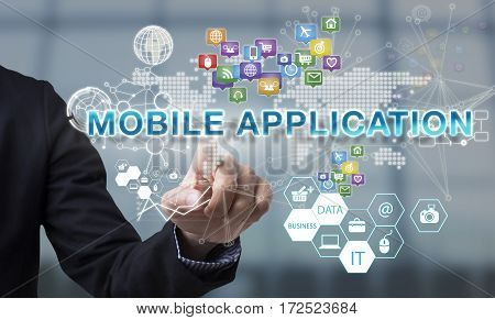 Businessman hand chooses Mobile application wording on interface screen. internet technology service concept. can used for cover page presentation and web banner.