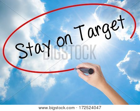 Woman Hand Writing Stay On Target With Black Marker On Visual Screen.