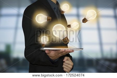Business hand holding light bulb. concept of new ideas with innovation and creativity.