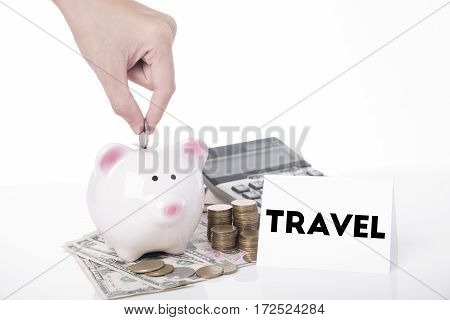 hand saving money in piggy bank for message travel.can used for cover page presentation and web banner. business finance concept.