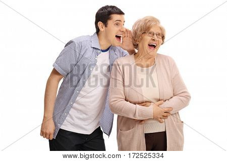 Young man whispering something funny to an elderly lady isolated on white background