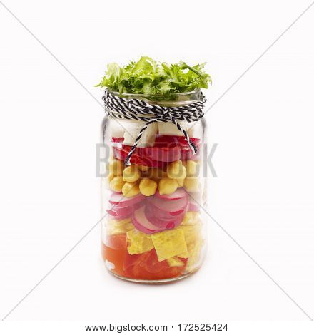 Salad in a jar. Healthy Homemade Mason Jar Salad isolated on white background. The concept of healthy proper nutrition for the whole family.