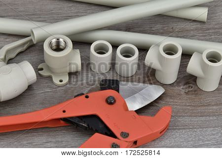 Components making water pipes and special scissors for cutting pipes.
