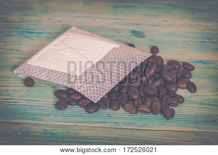 coffee drip package and coffee bean on wood