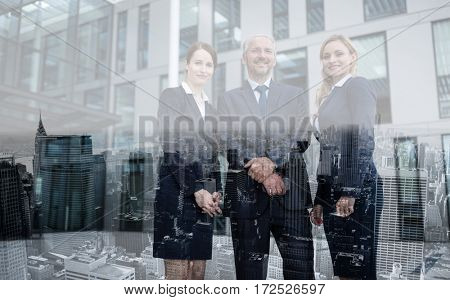 Portrait of confident businesspeople standing in office premises