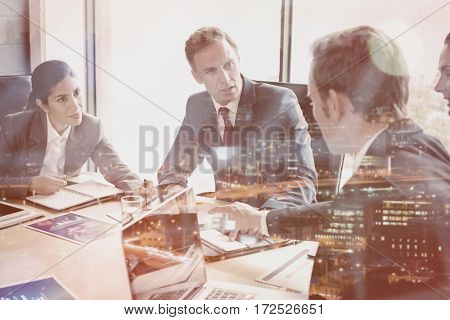 Business people interacting in conference room during meeting