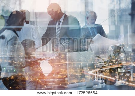 Business people seen through glass in office