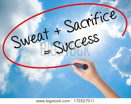 Woman Hand Writing Sweat + Sacrifice = Success With Black Marker On Visual Screen