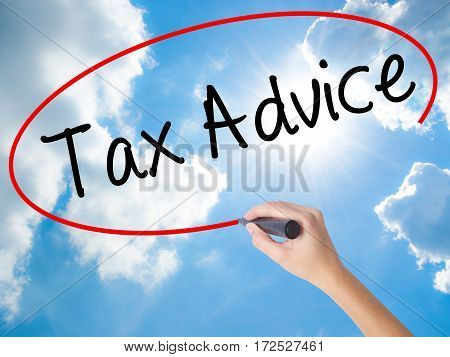 Woman Hand Writing Tax Advice With Black Marker On Visual Screen