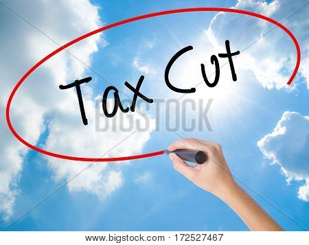 Woman Hand Writing Tax Cut With Black Marker On Visual Screen