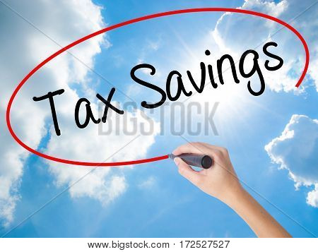 Woman Hand Writing Tax Savings With Black Marker On Visual Screen
