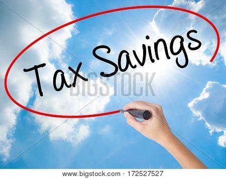 Woman Hand Writing Tax Savings With Black Marker On Visual Screen