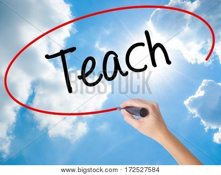 Woman Hand Writing Teach With Black Marker On Visual Screen.