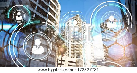 Buildings in city against futuristic technology interface