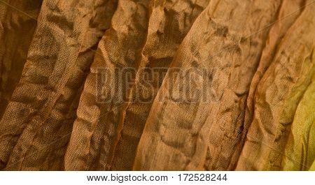 highly orange wrinkled crinkled silk cloth texture