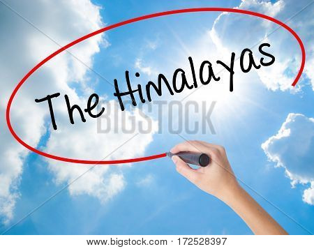 Woman Hand Writing The Himalayas With Black Marker On Visual Screen