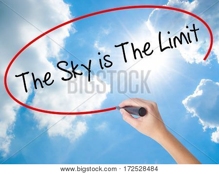 Woman Hand Writing The Sky Is The Limit  With Black Marker On Visual Screen
