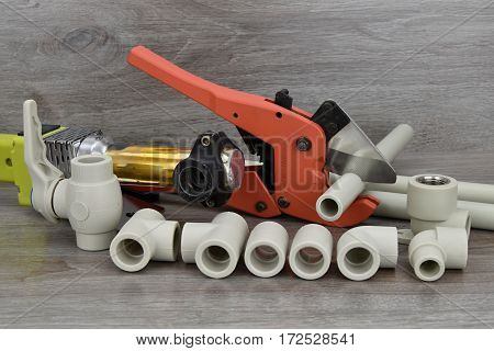 Components making water pipes. Plastic water pipeline.