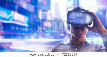 Man using an oculus against blurred new york street