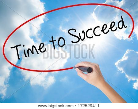 Woman Hand Writing Time To Succeed With Black Marker On Visual Screen