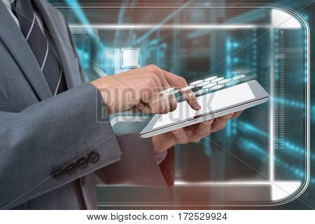 Midsection of businessman using tablet computer against blue vignette background