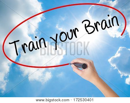 Woman Hand Writing Train Your Brain With Black Marker On Visual Screen