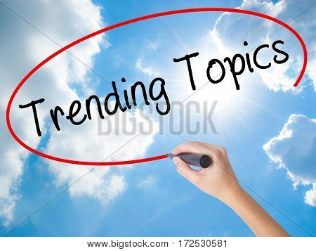 Woman Hand Writing Trending Topics With Black Marker On Visual Screen