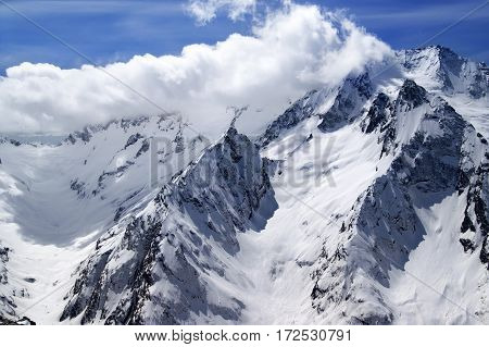 Winter Snow Mountains And Blue Sky With Clouds In Nice Sun Day
