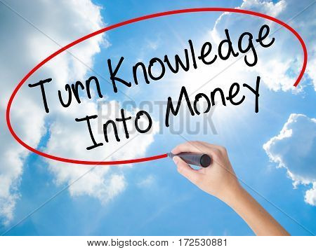 Woman Hand Writing Turn Knowledge Into Money With Black Marker On Visual Screen