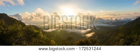 Sunrise at Doi Ang Khang in Chiang Mai, Thailand. Clouds over the mountains. Panorama shot