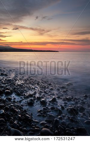 Long exposure sunset photo at Amed beach, Bali, Indonesia