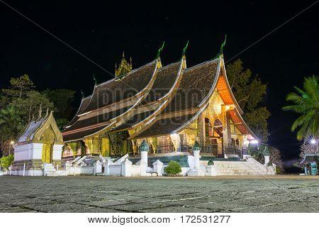 Wat Xieng Thong temple at night in Luang Prabang, Laos