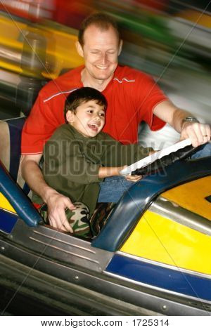 Father And Son Enjoying The Bumper Car