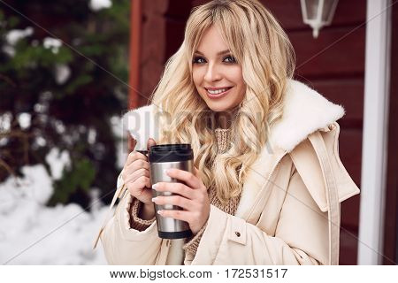 Georgeous Elegant Blonde In Bright Dress With Cup Of Tea