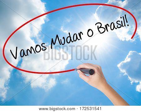 Woman Hand Writing Vamos Mudar O Brasil! (let's Change Brazil In Portuguese)  With Black Marker On V