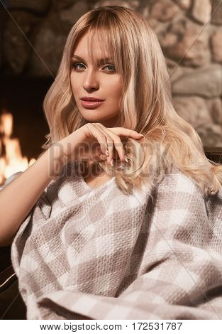Georgeous Elegant Blonde Under Bright Plaid Near Fireplace
